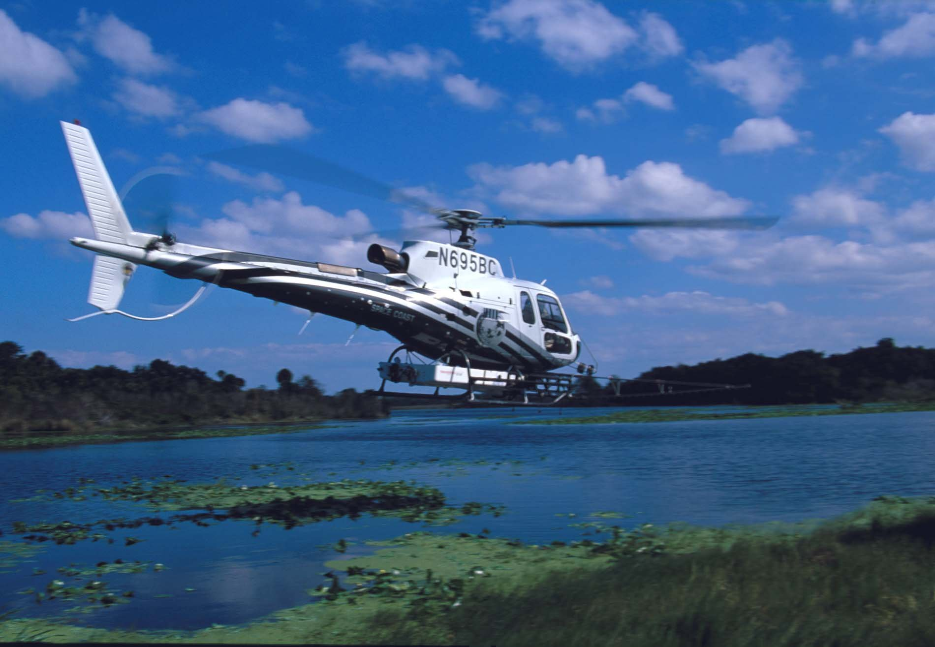 brevard-county-mosquito-control-astar-helicopter-over-marsh